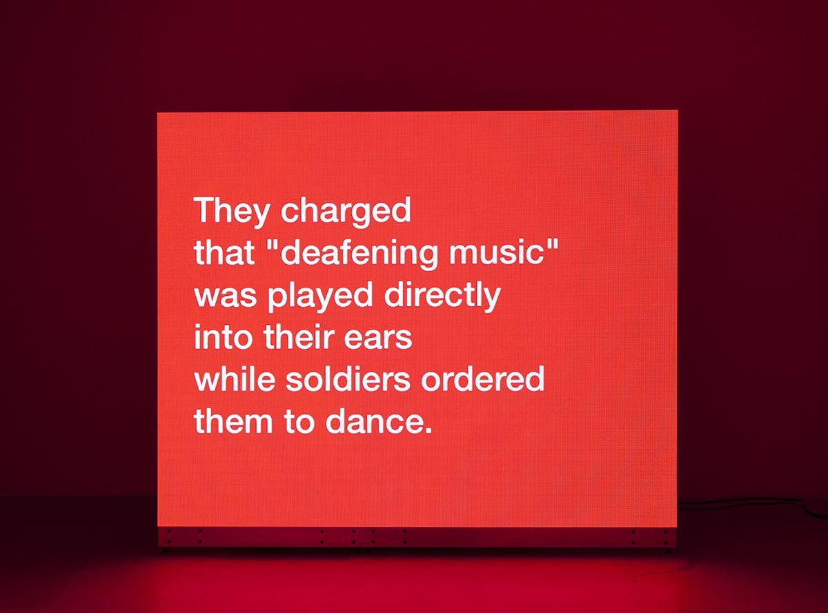 Tony Cokes Evil.16 (Torture.Musik), 2009-2011 Digital video, color, stereo 16:27 minutes