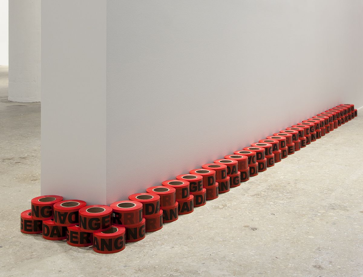 Danger, 2017 Danger tape, printed plastic 66 rolls: 2 7/8 x 5 3/4 inches (7.3 x 14.6 cm) each Overall dims: 5 3/4 x 198 x 5 3/4 inches (14.6 x 502.9 x 14.6 cm)