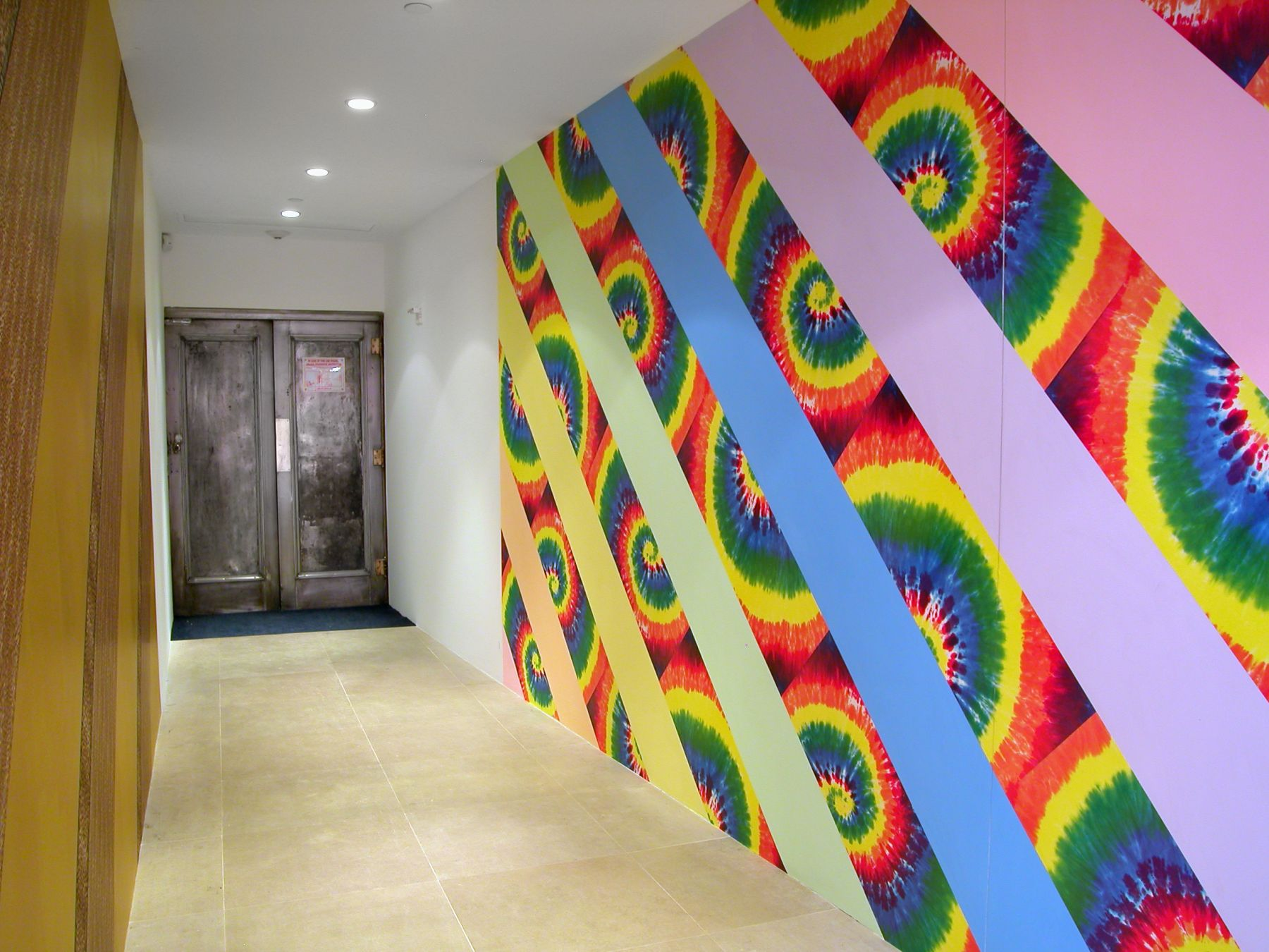 Jim Drain, I Would Gnaw on My Hand (Hallway), 2007, tie-dye and leopard print wallpaper, latex paint, Dimensions variable