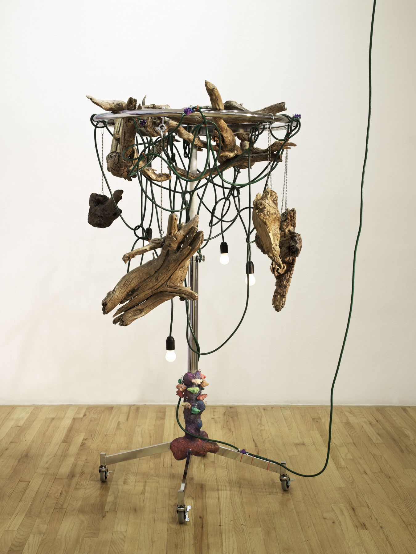 Haegue Yang Wild in Aspen: Giant Fingers, 2011 Round clothing rack (chrome) on casters, light bulbs (frosted), electric cable,chain, nylon cord, key rings, varnish, shower curtain holders, papier mache, and driftwood 75 1/4 x 45 x 44 5/8 inches 191.1 x 114.3 x 113.3 cm