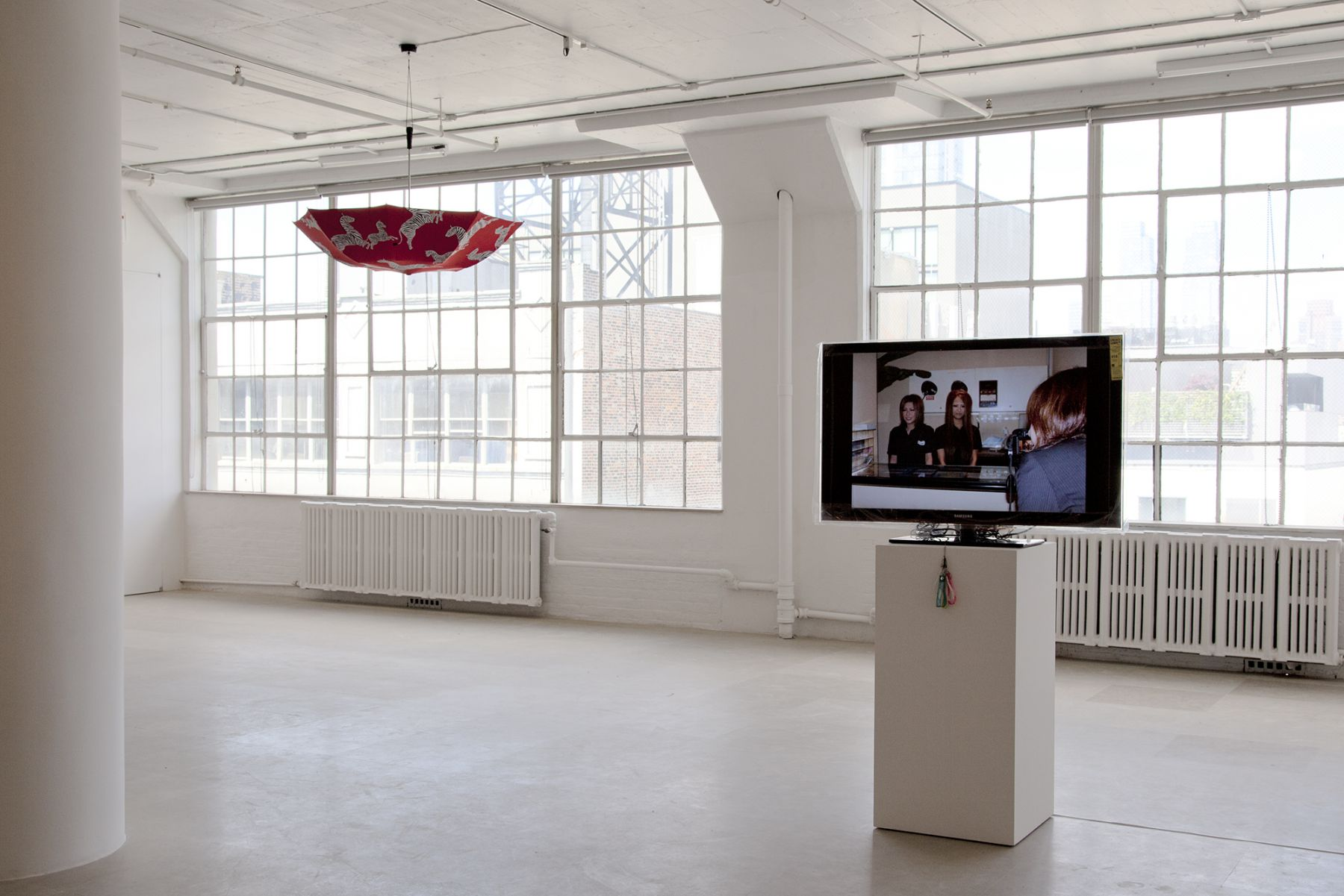 Ei Arakawa / United Brothers (w/ Das Institut), BLACKY Blocked Radiants Sunbathed, 2011, Digital projection of 185 slides with a set of mobile straps, Dimensions variable, Ed. 1/3, 2 APs, Installation view, Greene Naftali, New York, 2011
