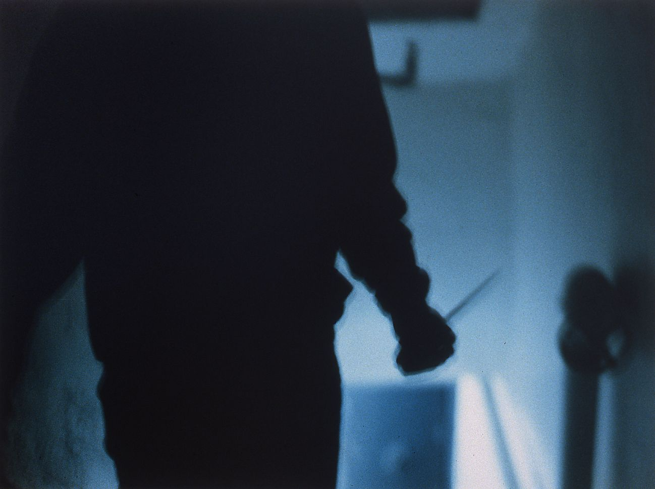 Josephine Meckseper, The Great Escape (Man with a knife), 1996, c-print, 30 x 40 inches