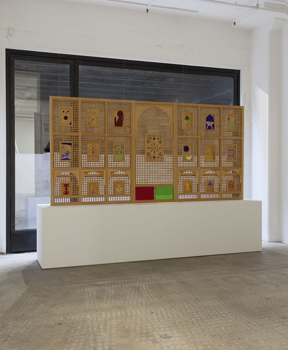 Katharina Wulff  Tifaout ntitrit, 2014  Mashrabiya, Cedar wood, Iraqi glass  Overall Dimensions: 69 1/4 x 141 11/16 x 2 1/8 (175.8 x 359.8 x 5.3 cm)  Left Panel: 69 1/4 x 55 1/16 x 2 1/8 (175.8 x 139.8 x 5.3 cm)  Center Panel: 69 3/16 x 31 1/2 x 2 1/8 (175.7 x 80 x 5.3 cm)  Right Panel: 69 1/4 x 55 1/4 x 2 1/8 (175.8 x 140.3 x 5.3 cm)