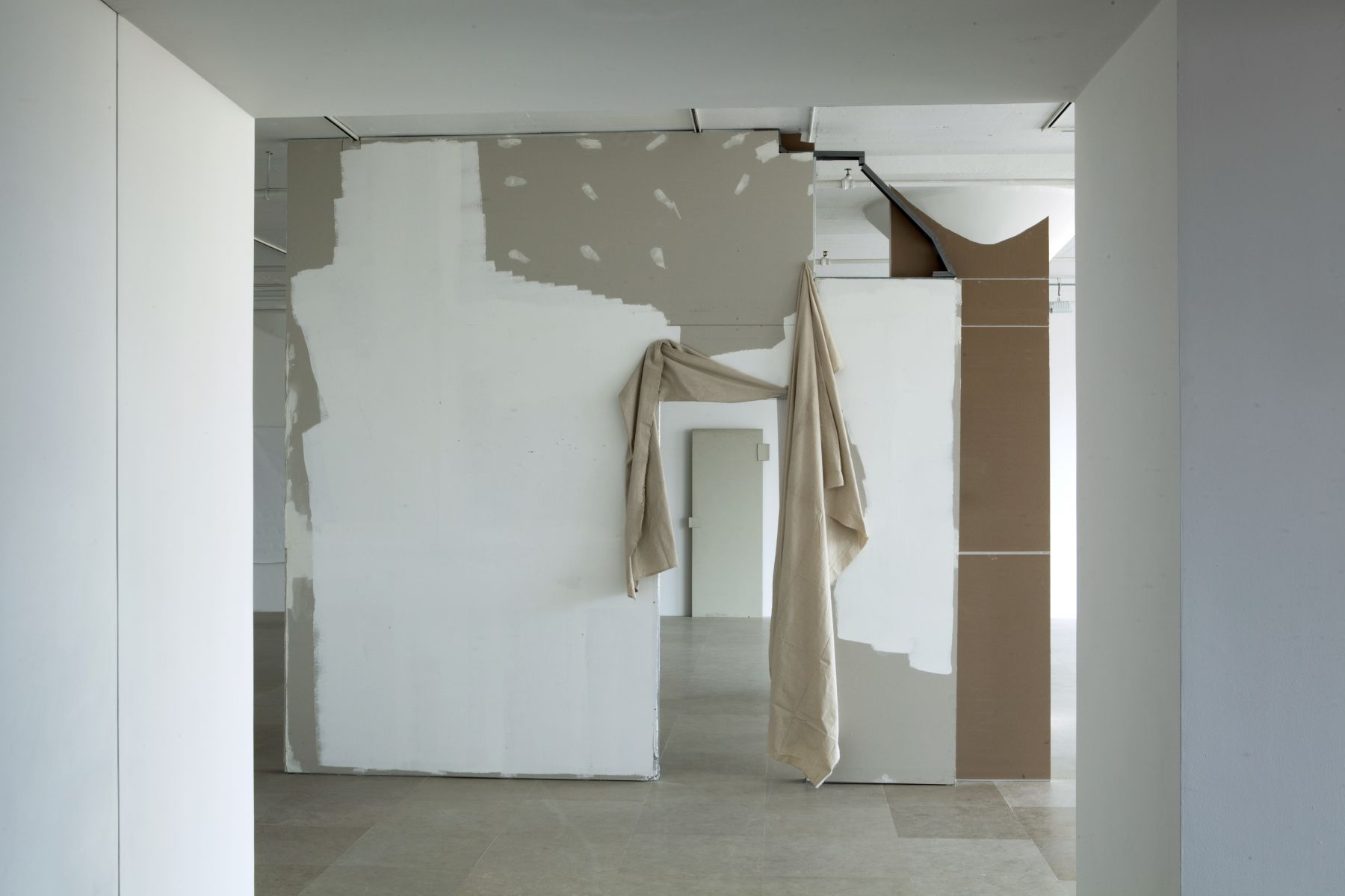Gedi Sibony The Cutters, 2007 / 2010 Sheetrock wall, paint, hollow core door fragment, vinyl, canvas drop cloth, metallic tape 137 x 164 x 13 inches 348 x 416.6 x 33 cm