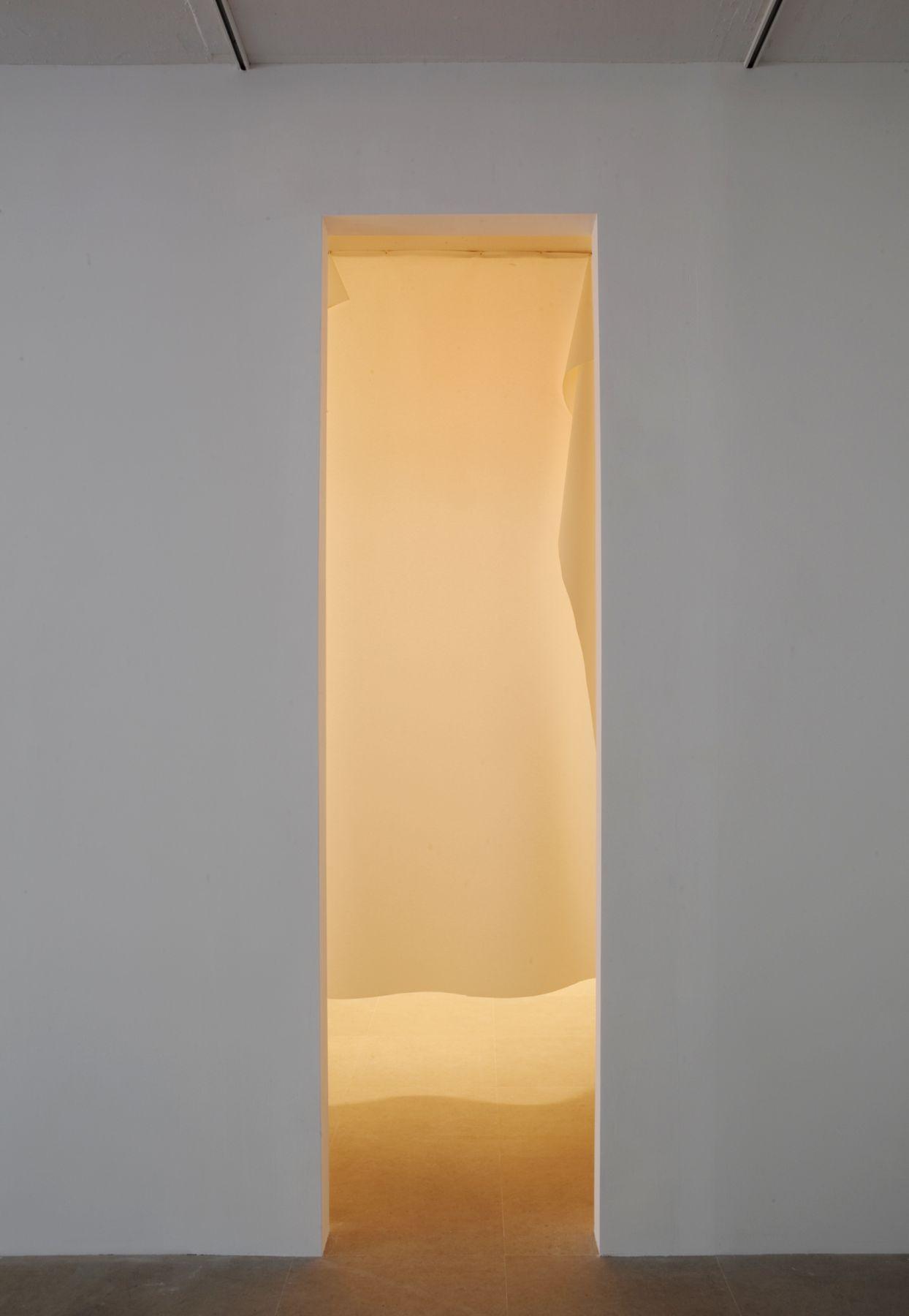 Gedi Sibony The Brighter Grows the Lantern, 2010 Vinyl, nails, light, room 137 x 313 x 133 1/2 inches (348 x 795 x 339 cm)