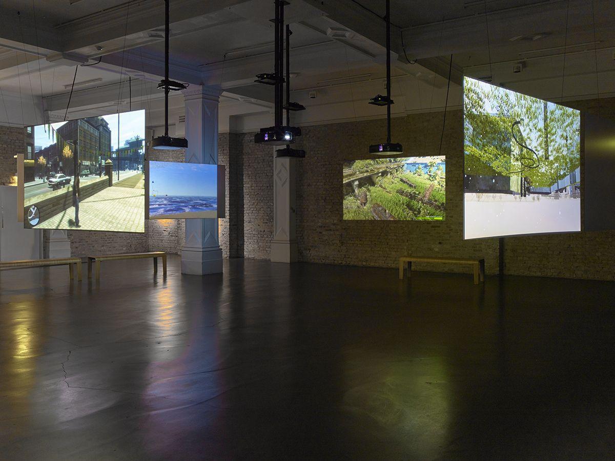 Harun Farocki  Parallel I-IV, 2013-2014  2 two-channels video, 2 one-channel video  4 parts video installation: 16 min, 9 min, 7 min, 11 min  Installation view, Whitechapel Gallery, London, 2016