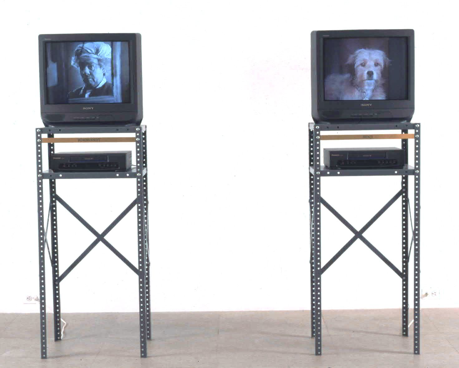 Jonathan Horowitz, Dot, 1998, 2 VHS tapes and 2 metal shelves, dimensions variable