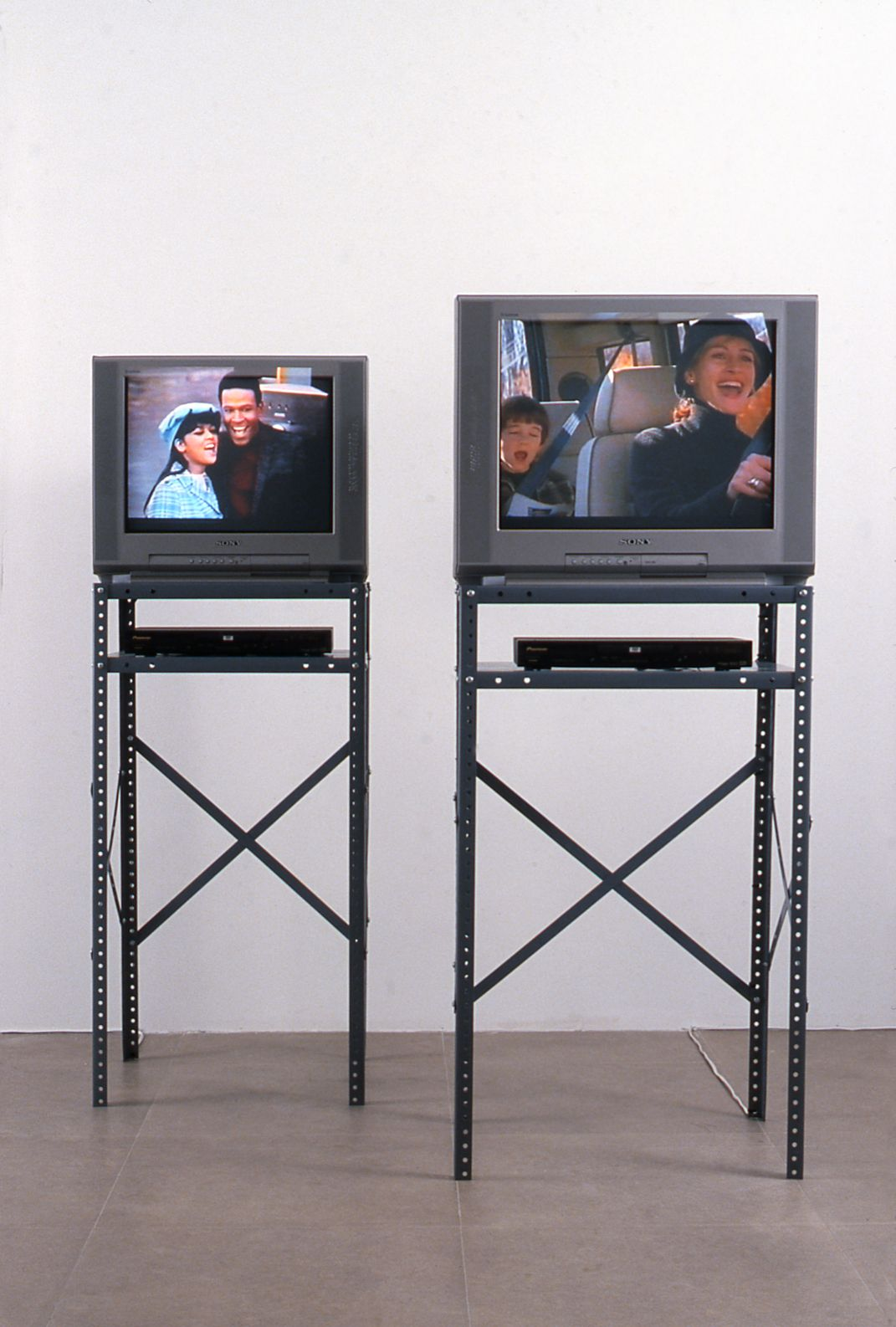 """The Soul of Tammi Terrell, 2001, 2 DVDs 5:30 min each, 2 metal stands, 24"""" monitor, 20"""" monitor, 2 DVD players"""