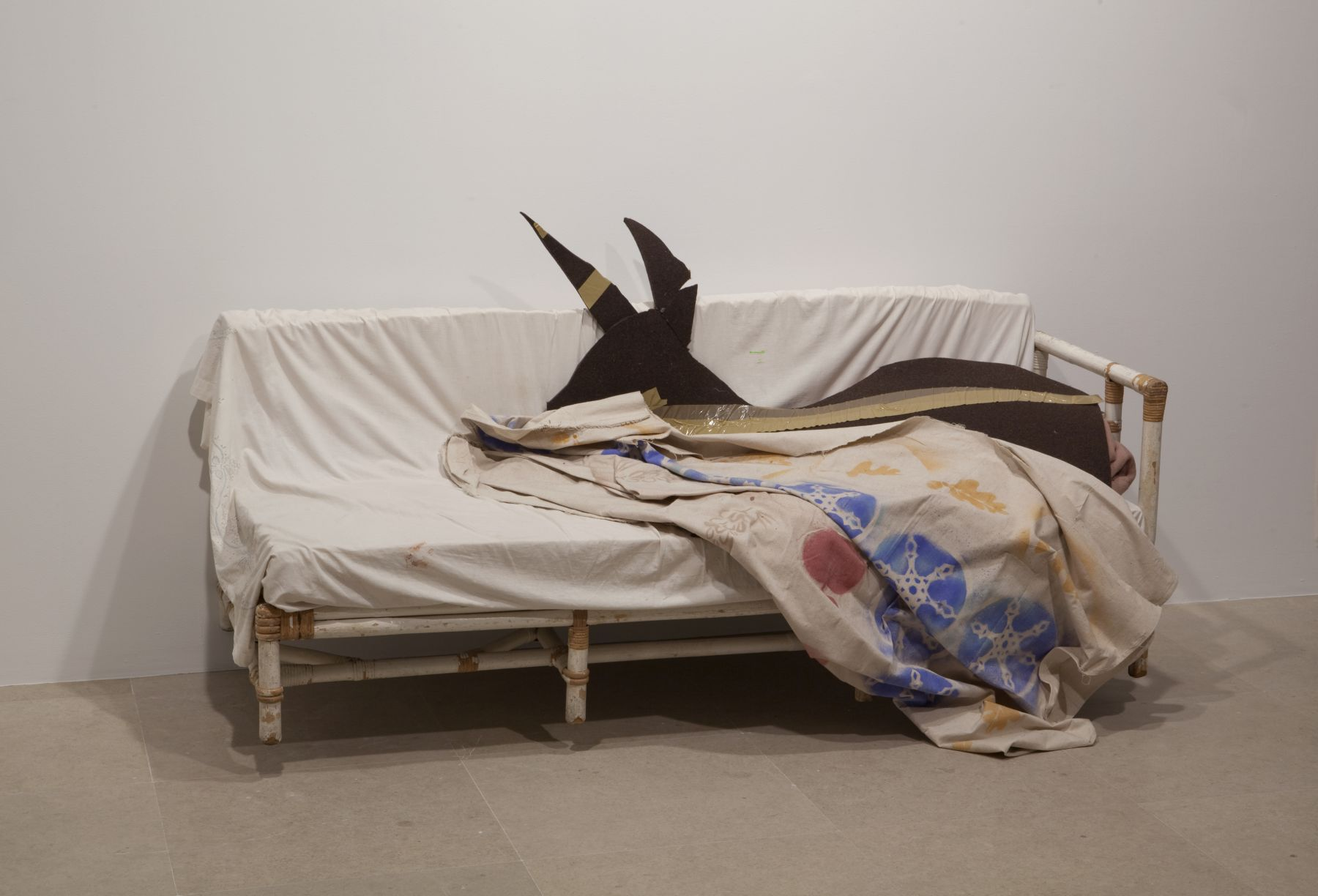 Gedi Sibony (with Diana Lyon), Who Attracts All That is Named, 2010, couch, bed sheet, wool blanket, felt, tape, canvas and spraypaint, dimensions variable