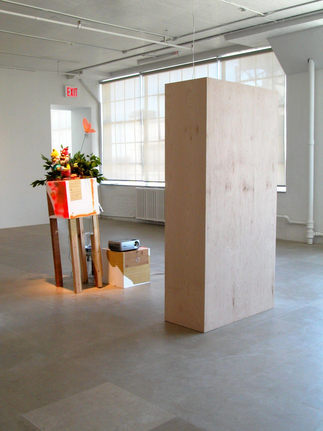 Rachel Harrison, Double Vision, 2006-2008, wood, shelf liner, metal, plastic, fake foliage, confetti, DVD player, projector, apple sound sticks, Simon LeBon mirrors, 78 x 36 x 18 inches