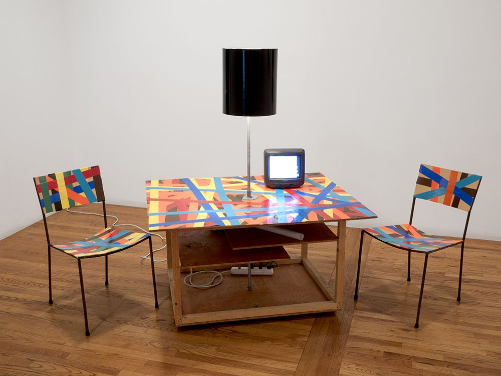Franz West Creativity: Furniture Reversal, 1998 Two chairs, table, lamp, colored duct tape and video (which collapses into its own crate)