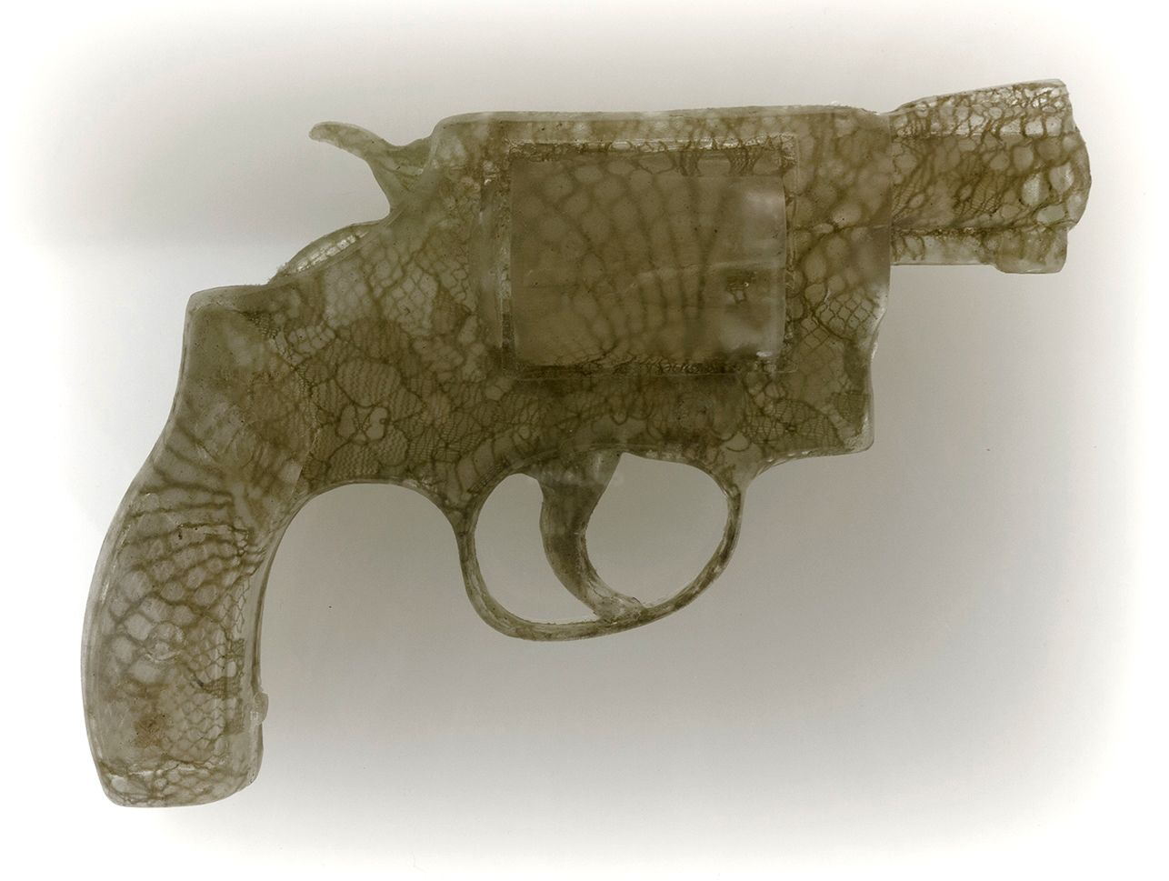 Nikki Luna Quince (7), 2016 Cast resin and lace handgun in lightbox