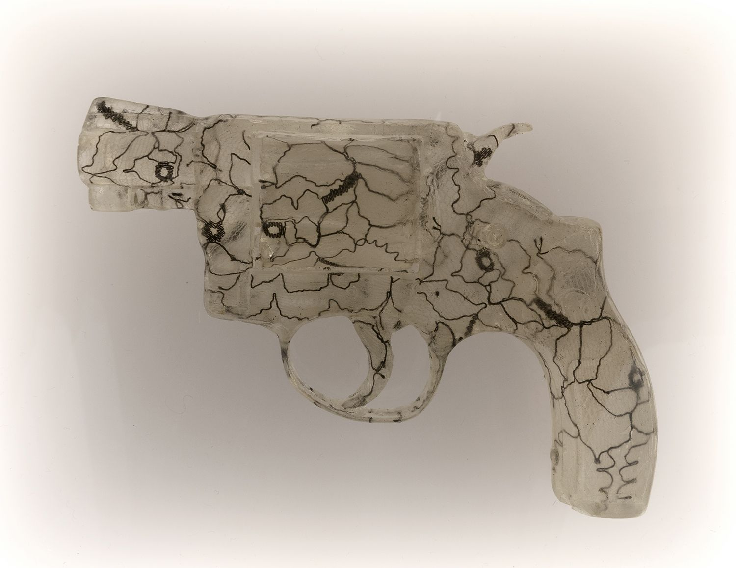 Nikki Luna Quince (6), 2016 Cast resin and lace handgun in lightbox