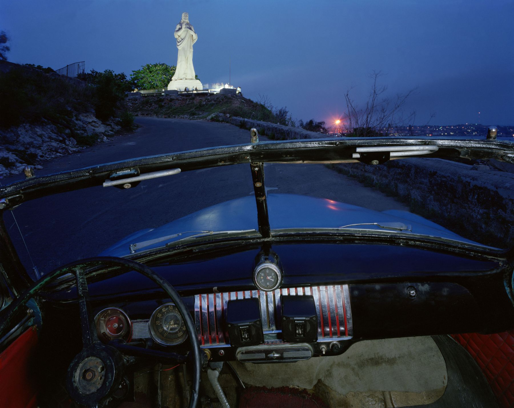 ALEX HARRIS  El Cristo de Casablanca, looking west from Ricardo Moya Silveira's 1951 Chevrolet, Havana May 24, 1998