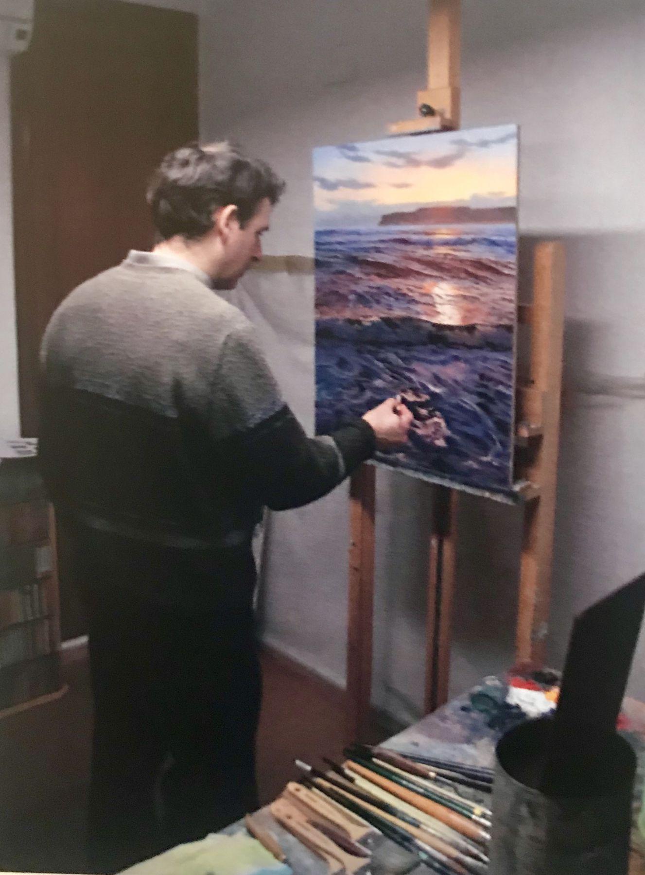 Navarro Painting in his Studio