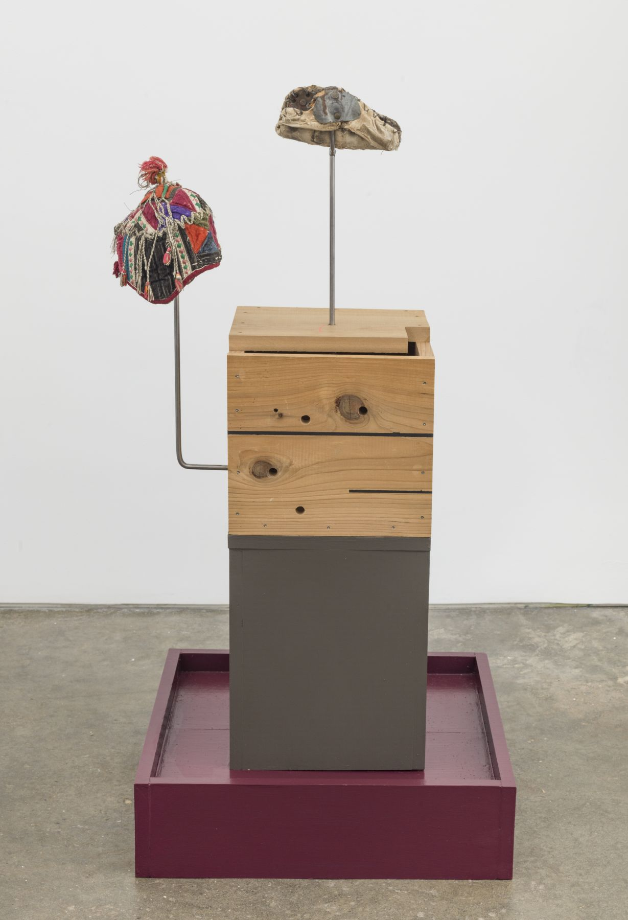 Untitled, 2018, Chinese baby hat, metal welder glove, wooden bases