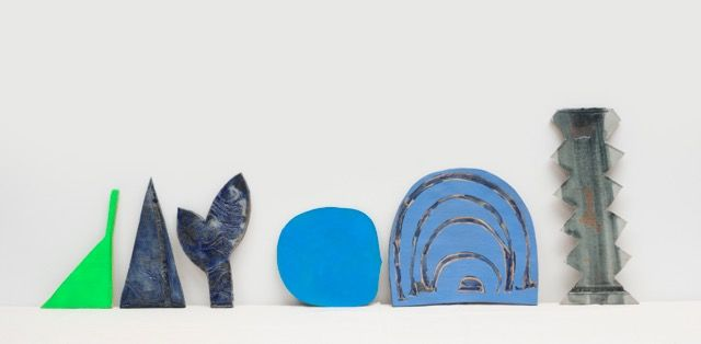 "Leslie Baum, this&that:the blues, glazed, stained and spray-painted stoneware on canvas covered wood shelf, 18"" x 50"", 2016"