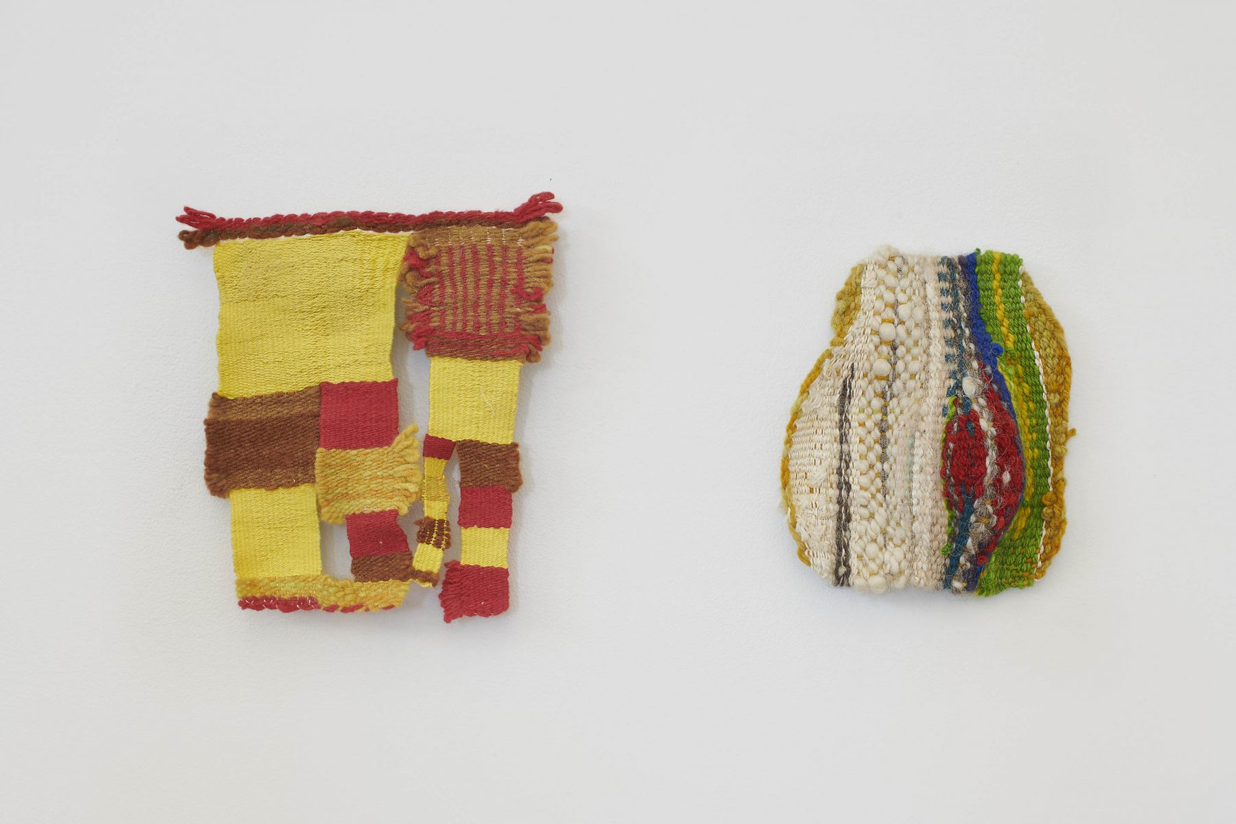 Two colorful and small weavings by Kristine Woods.