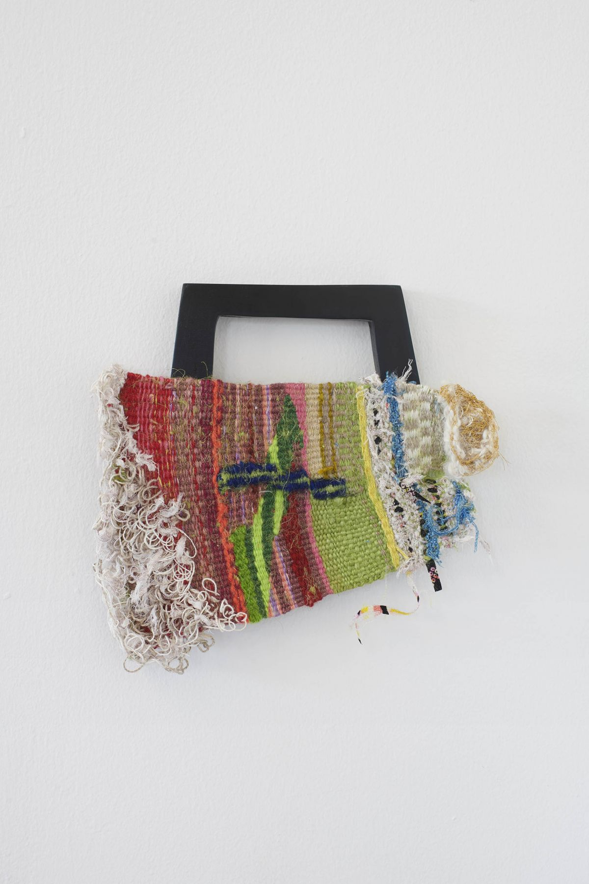 A small colorful weaving shaped like a clutch purse
