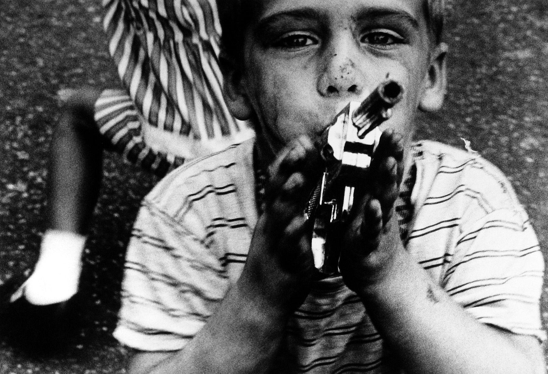 William Klein - Boy + Gun + Striped Dress, New York, 1955 - Howard Greenberg Gallery - 2018