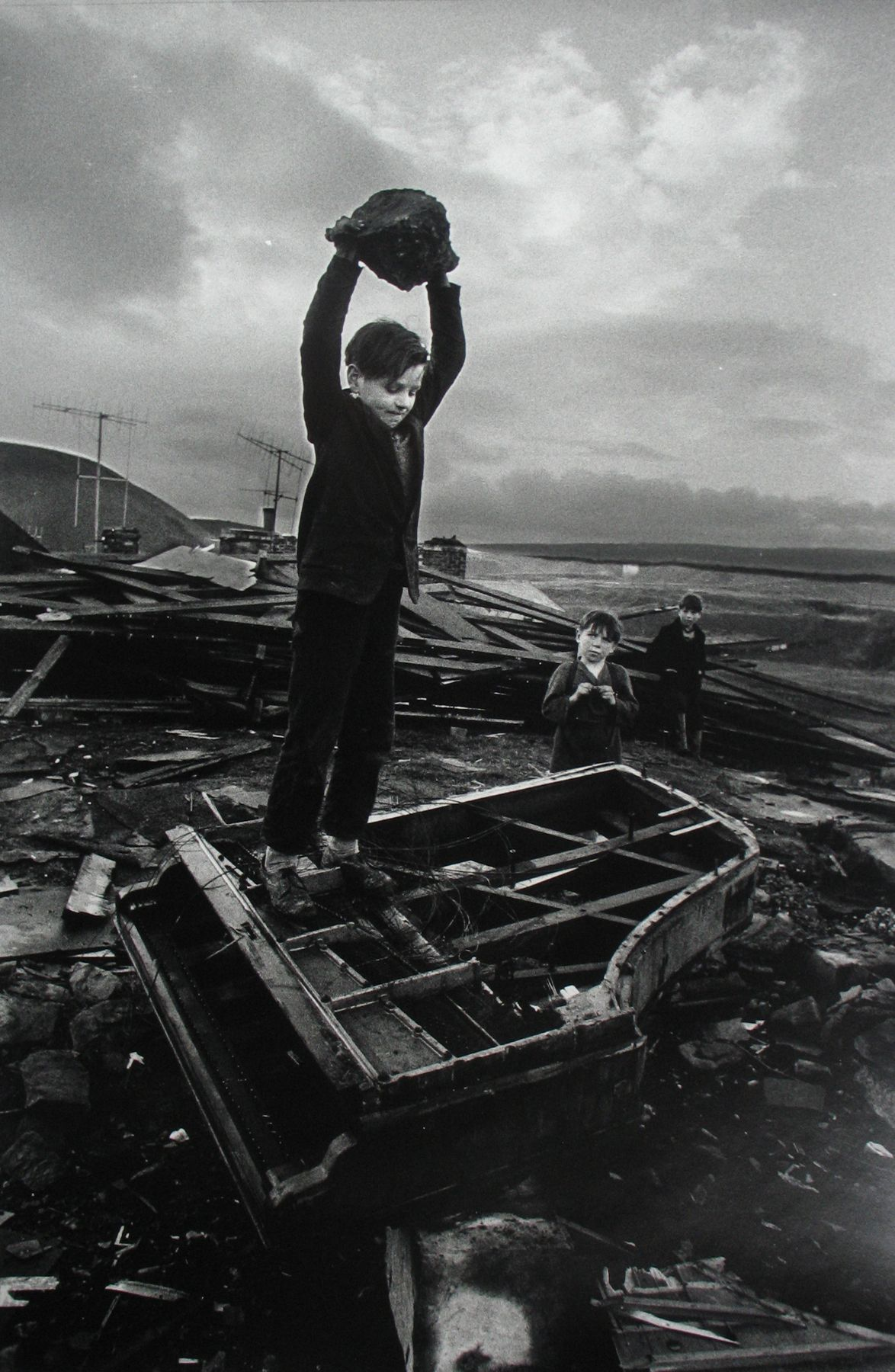 Philip Jones Griffiths - Boy Destroying Piano, Wales, 1961 - Howard Greenberg Gallery - 2018
