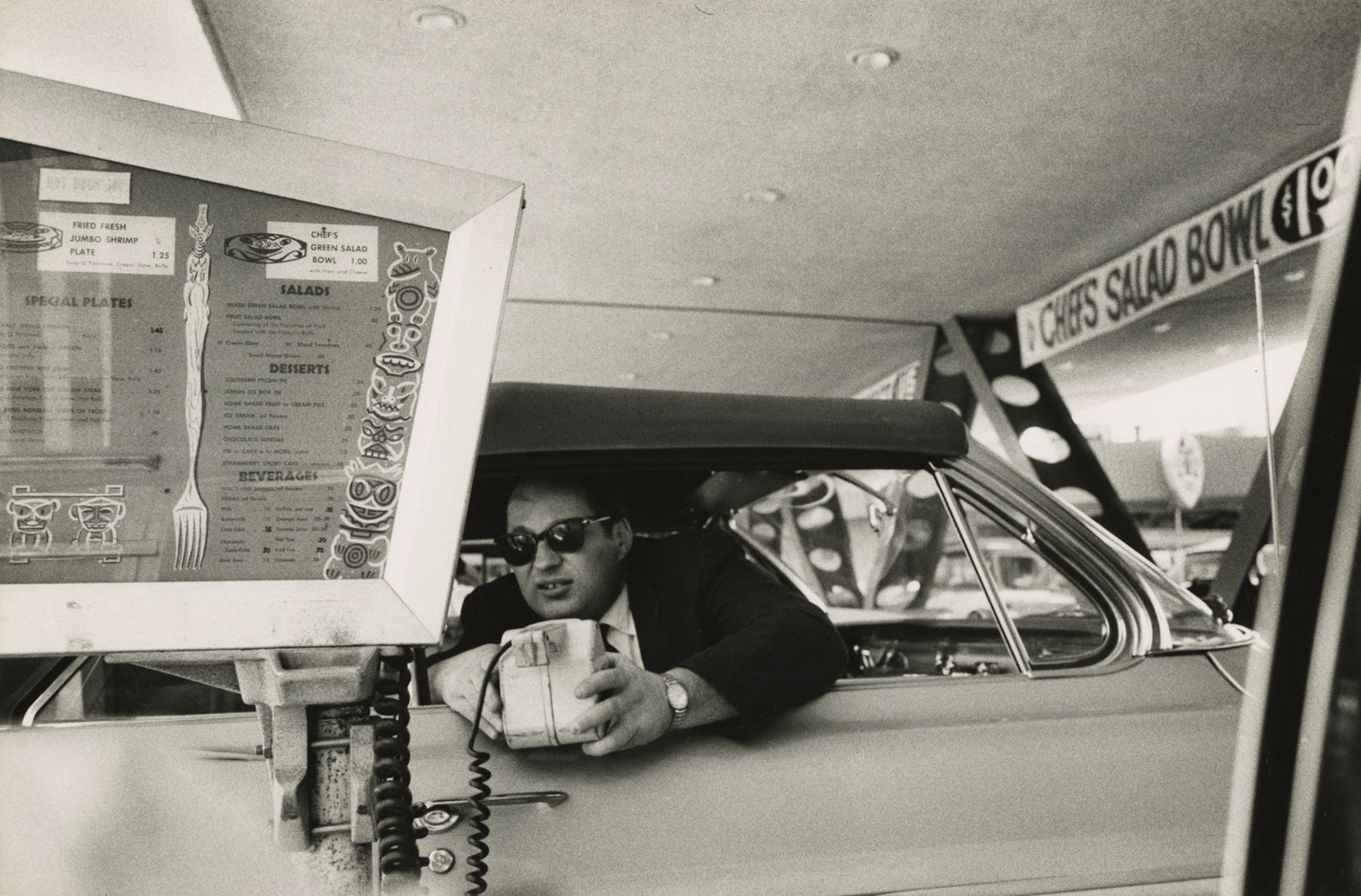 Bruce Davidson - Los Angeles (man leaning out of car window in drive-thru), 1964 - Howard Greenberg Gallery - 2018