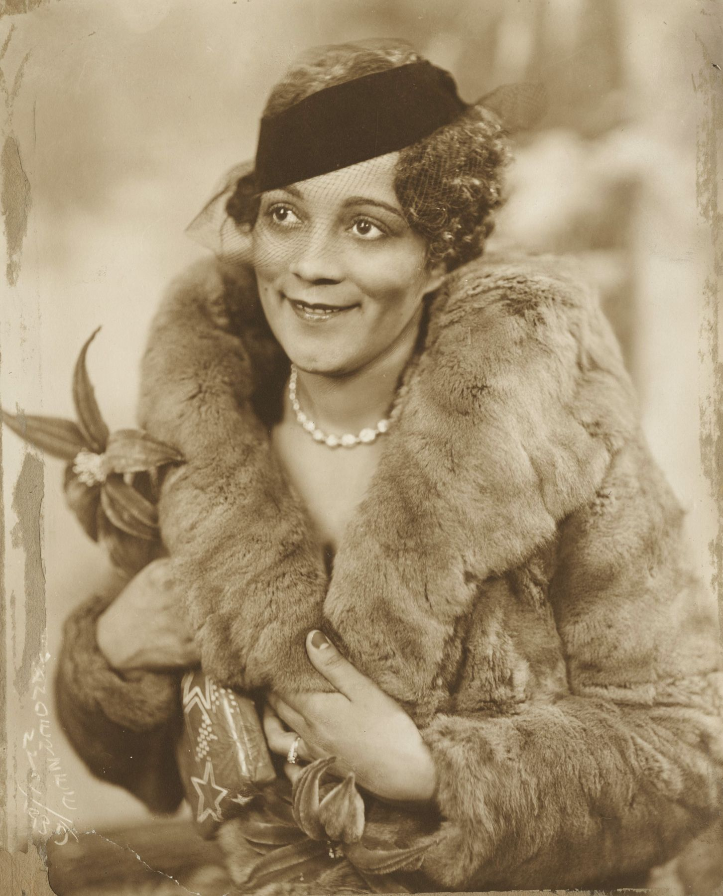 James Van Der Zee - Lady with Fur Jacket, 1935 - Howard Greenberg Gallery