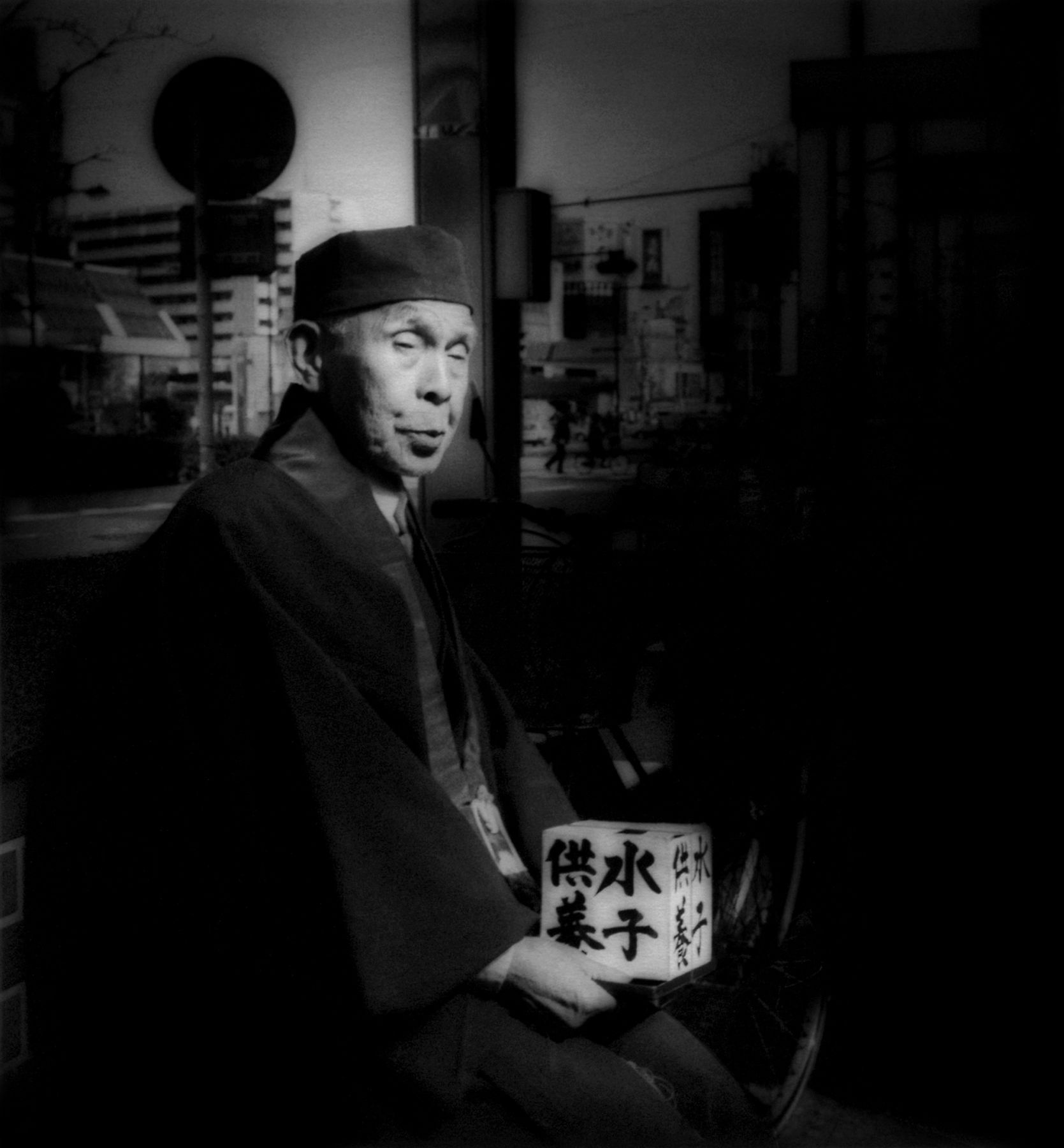 James Whitlow Delano, Mangaland, Scrutinized by fortuneteller, Sugamo, Tokyo, Japan, 1995, Sous Les Etoiles Gallery
