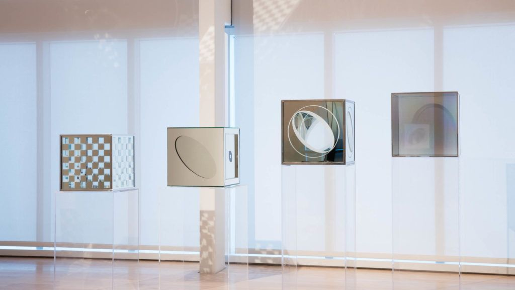 "ALT=""Larry Bell, Installation view of Larry Bell: Time Machines, 2018, Four laminated glass cubes"""
