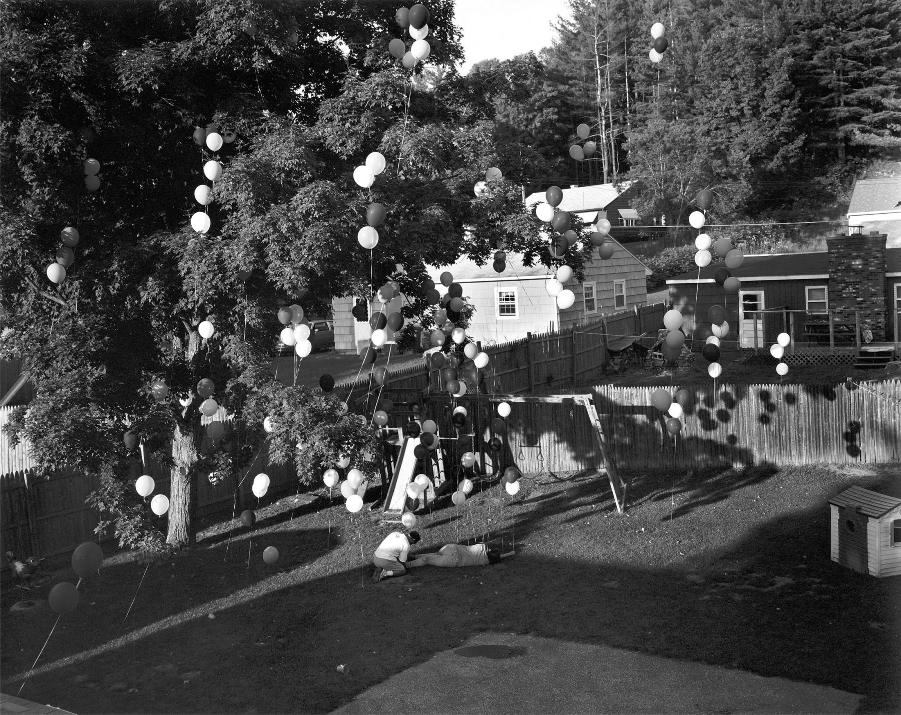 Gregory Crewdson, Untitled (balloons in backyard), 1997