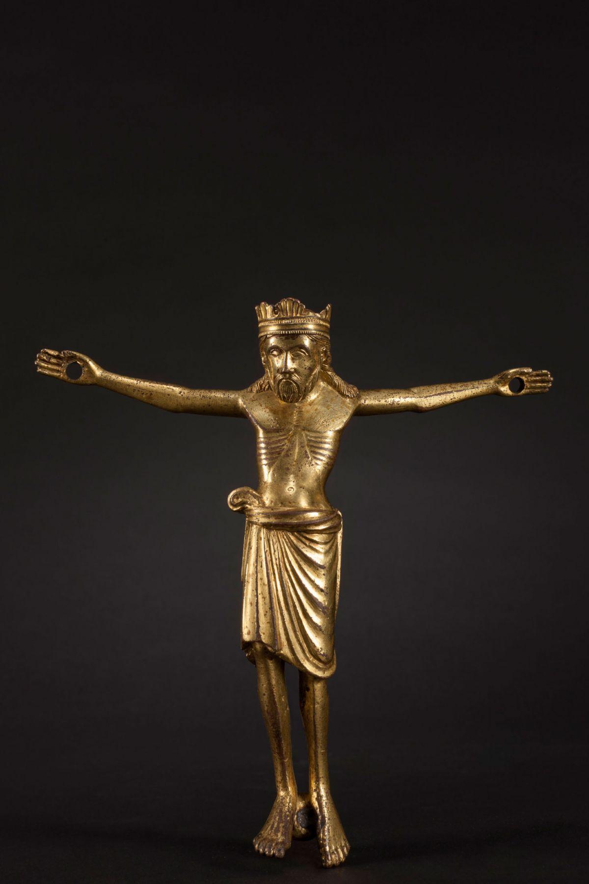 A gilded bronze corupus of Christ Triumphant, Meuse Valley