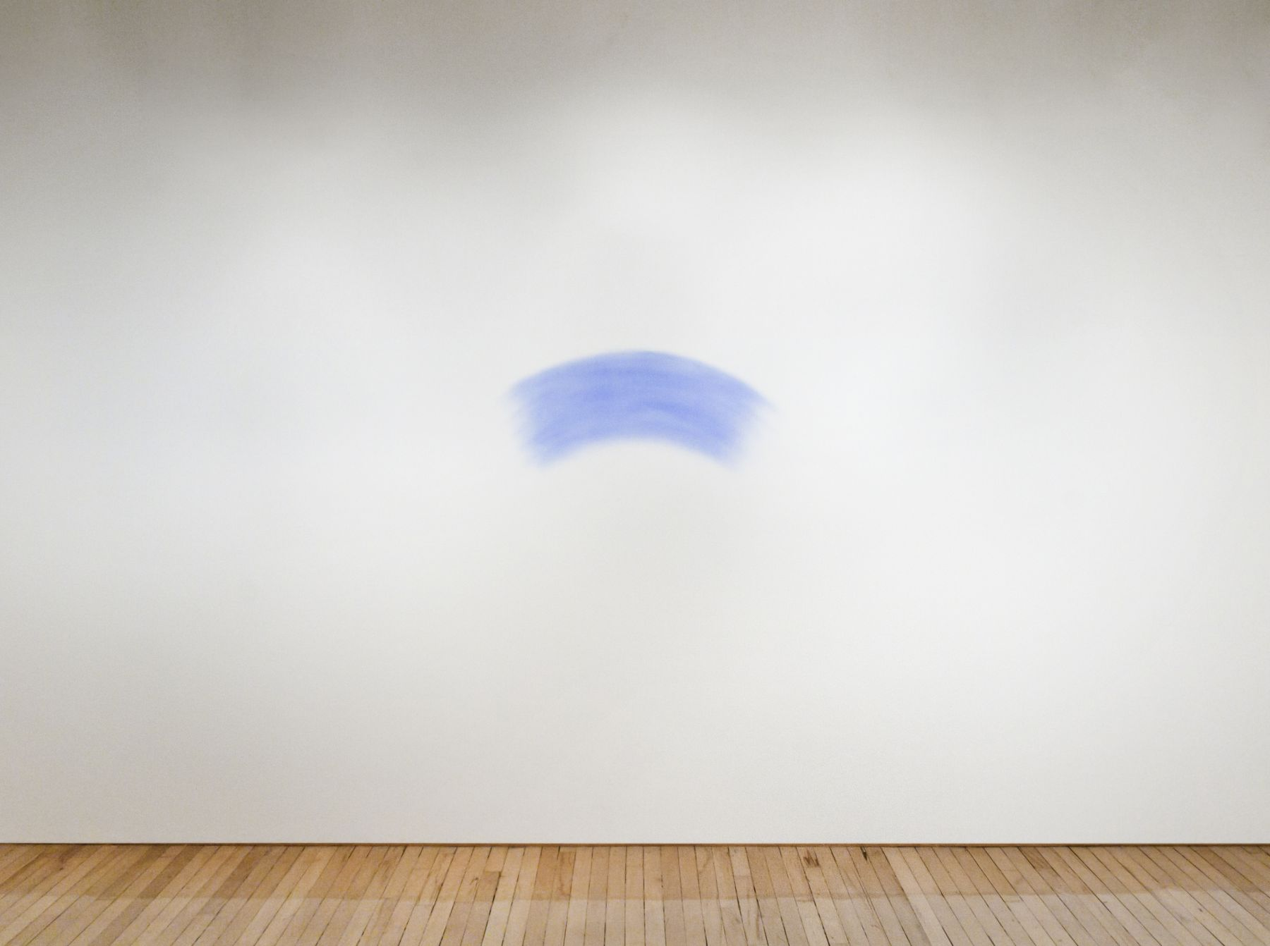 Mel Bochner,Smudge,1968. Blue powder pigment on wall, 17 x 39 inches.