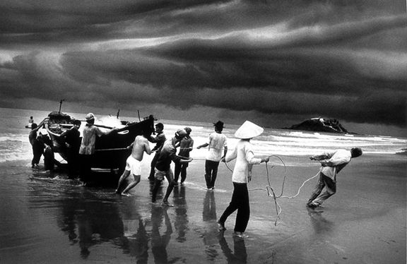 Fishermen on the beach of Vung Tau, Vietnam, from the series Migrations, 1995. 16 x 20, 20 x 24, 24 x 35, 36 x 50 or 50 x 68 inch gelatin silver print