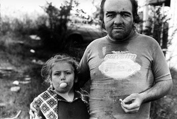 Girl Blowing Bubble with Father, 1986, 14 x 11 inches, gelatin silver print