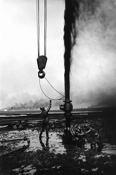 Shooting oil, Kuwait, from the series Workers, 1991, 20 x 16, 24 x 20, 35 x 24, 50 x 36 or 68 x 50 inch gelatin silver print
