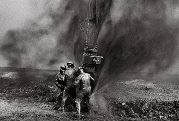 Capping a wellhead, Kuwait, from the series Workers, 1991. 16 x 20, 20 x 24, 24 x 35, 36 x 50 or 50 x 68 inch gelatin silver print