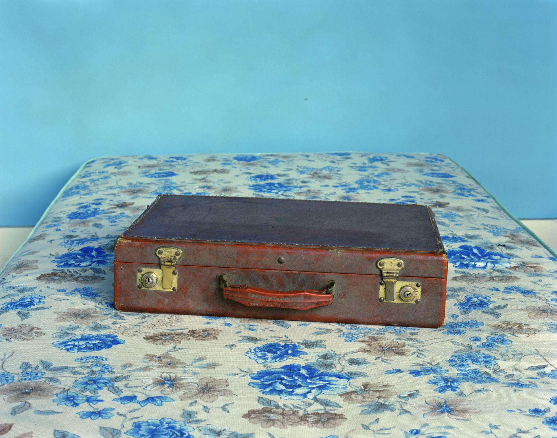 Dad's Briefcase, from the series Family Business, 2000. Chromogenic print, 30 x 40 inches.