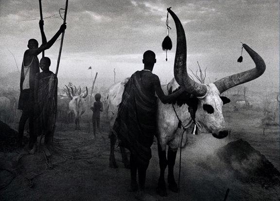 Dinka group at Pagarau, Southern Sudan, from the series Genesis, 2006. 16 x 20, 20 x 24, 24 x 35, 36 x 50 or 50 x 68 inch gelatin silver print