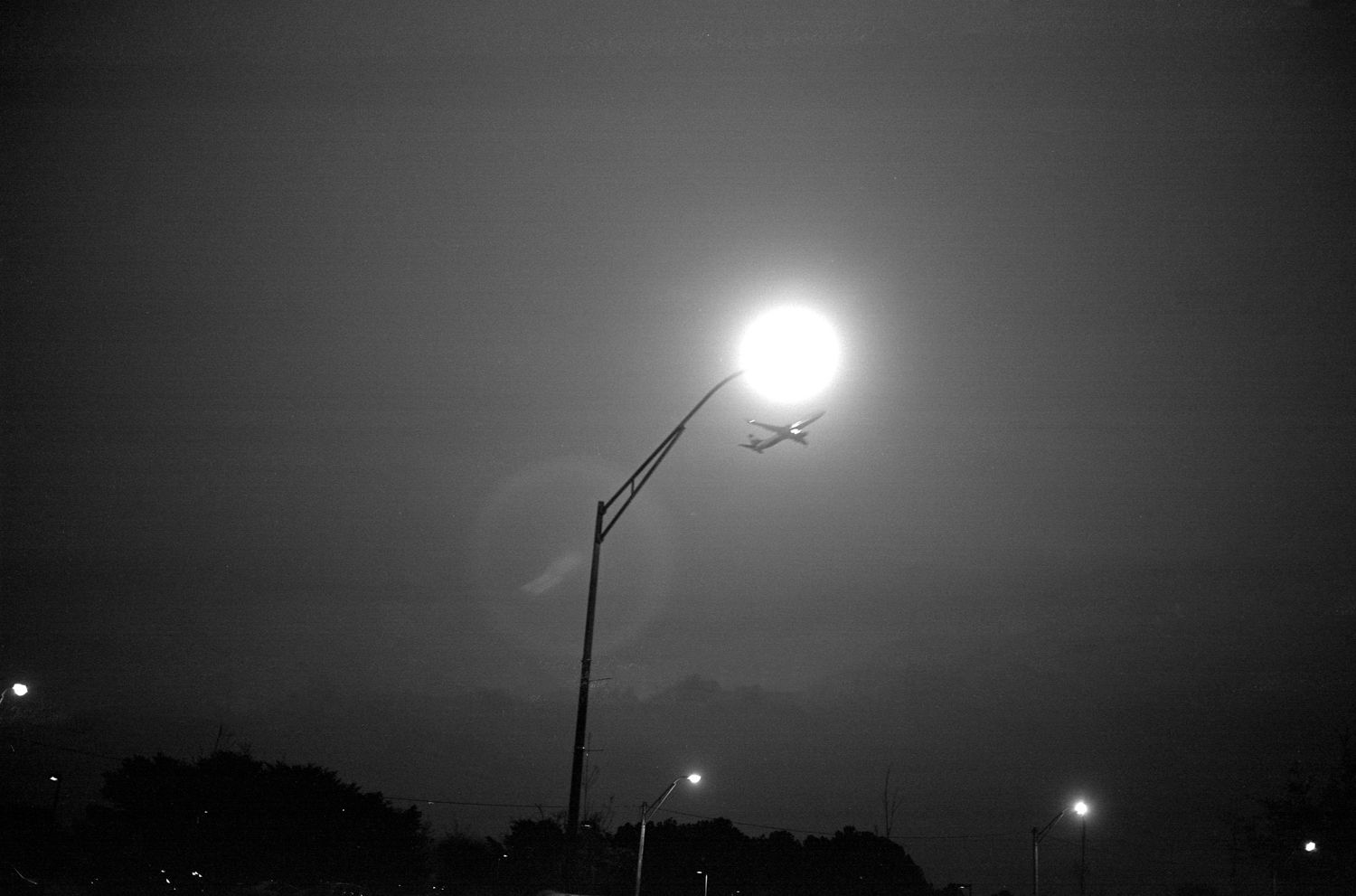 College Park, GA (plane and streetlight) 2016 Gelatin silver print, please inquire for available sizes