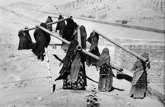 Women Carrying Pipes, Rajasthan Canal Works, India, from the series Workers, 1989. 16 x 20, 20 x 24, 24 x 35, 36 x 50 or 50 x 68 inch gelatin silver print