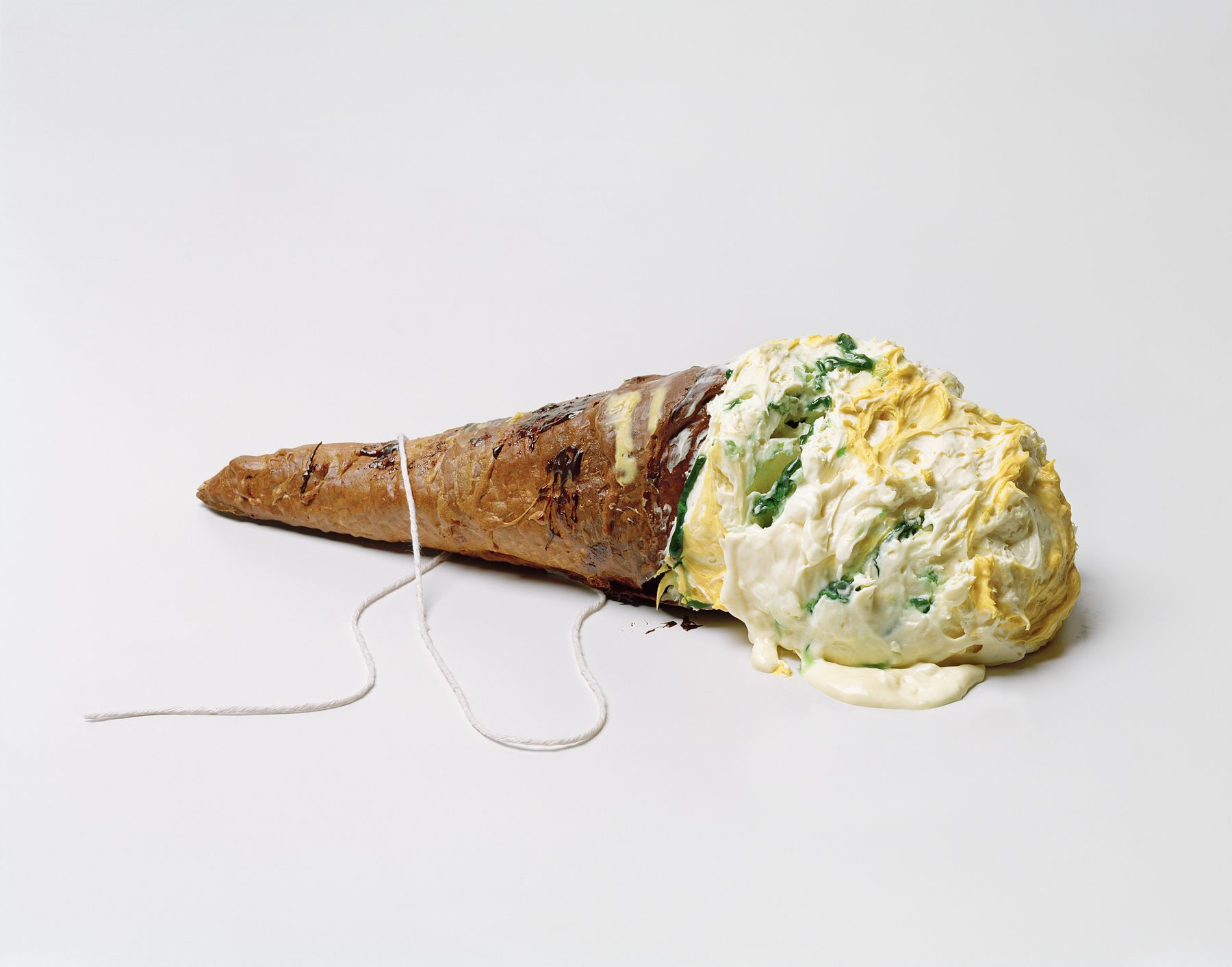 Photograph by Sharon Core. Ice cream cone lying on its side arranged to look like similar sculpture by Claes Oldenburg.