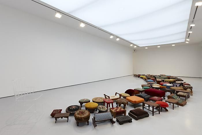 """Un-rest, 2010128 foot stools and 1 glass chairInstallation dimensions: 2' 10"""" x 39' 4"""" x 14' 6""""Chair dimensions: 33 x 18 x 20 in.VS 24"""