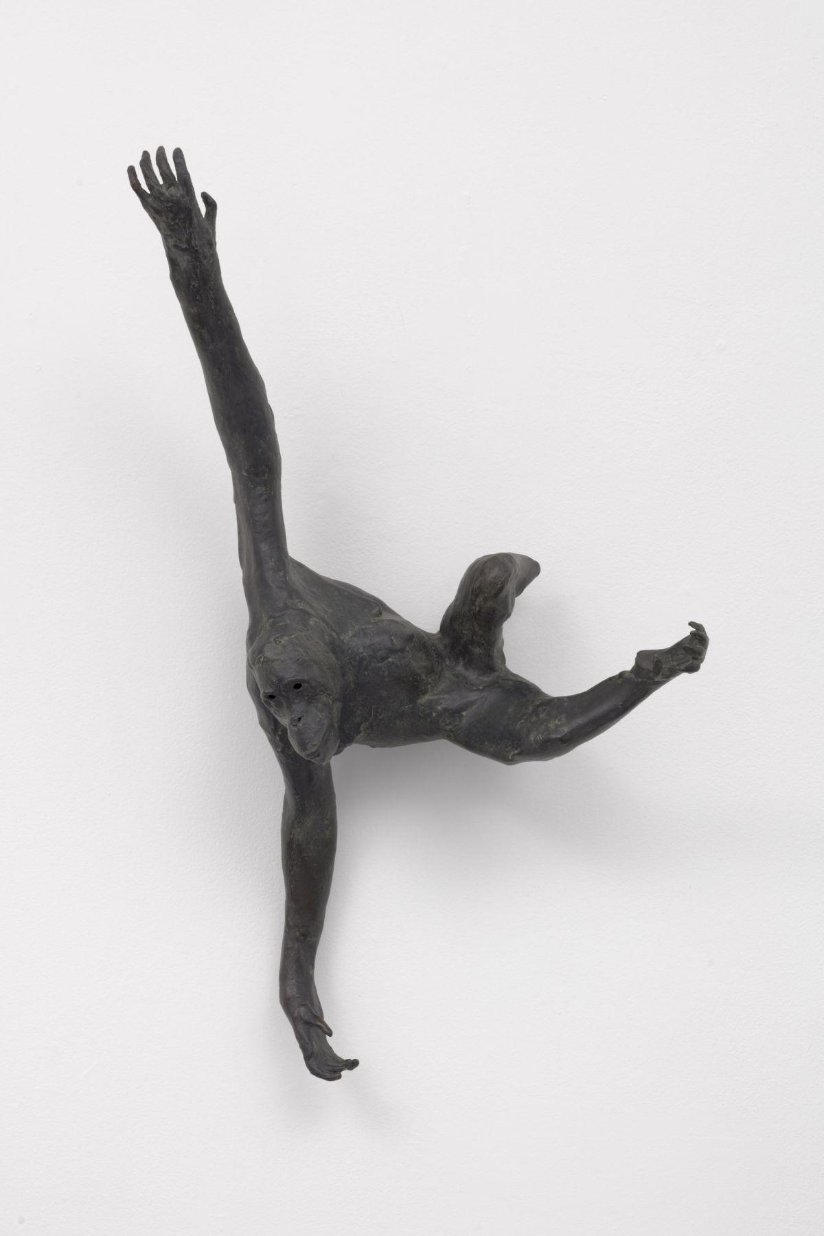 leaping bronze primate sculpture