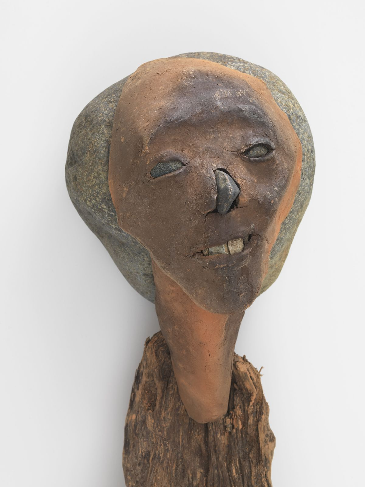 ceramic person with arms and legs made of wood