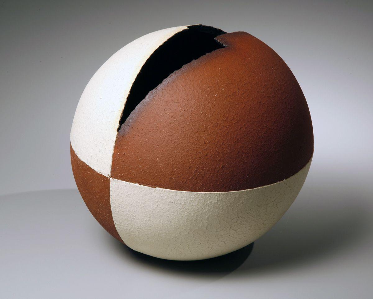 Spherical sculptural vessel with adjacent quadrants in crackled matte white glaze, 2007