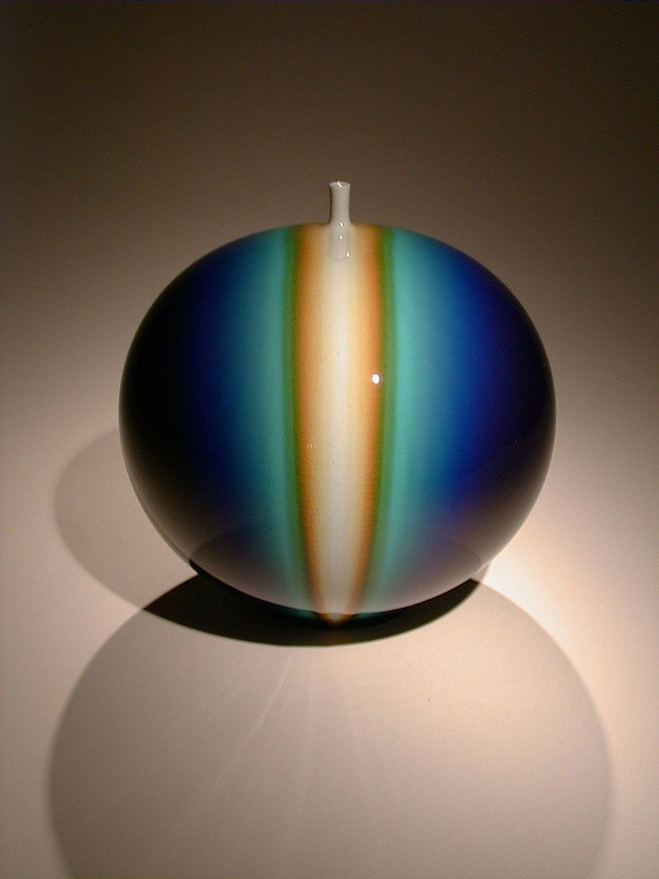 Blue globular vase with infused blue and yellow and a protruded mouth