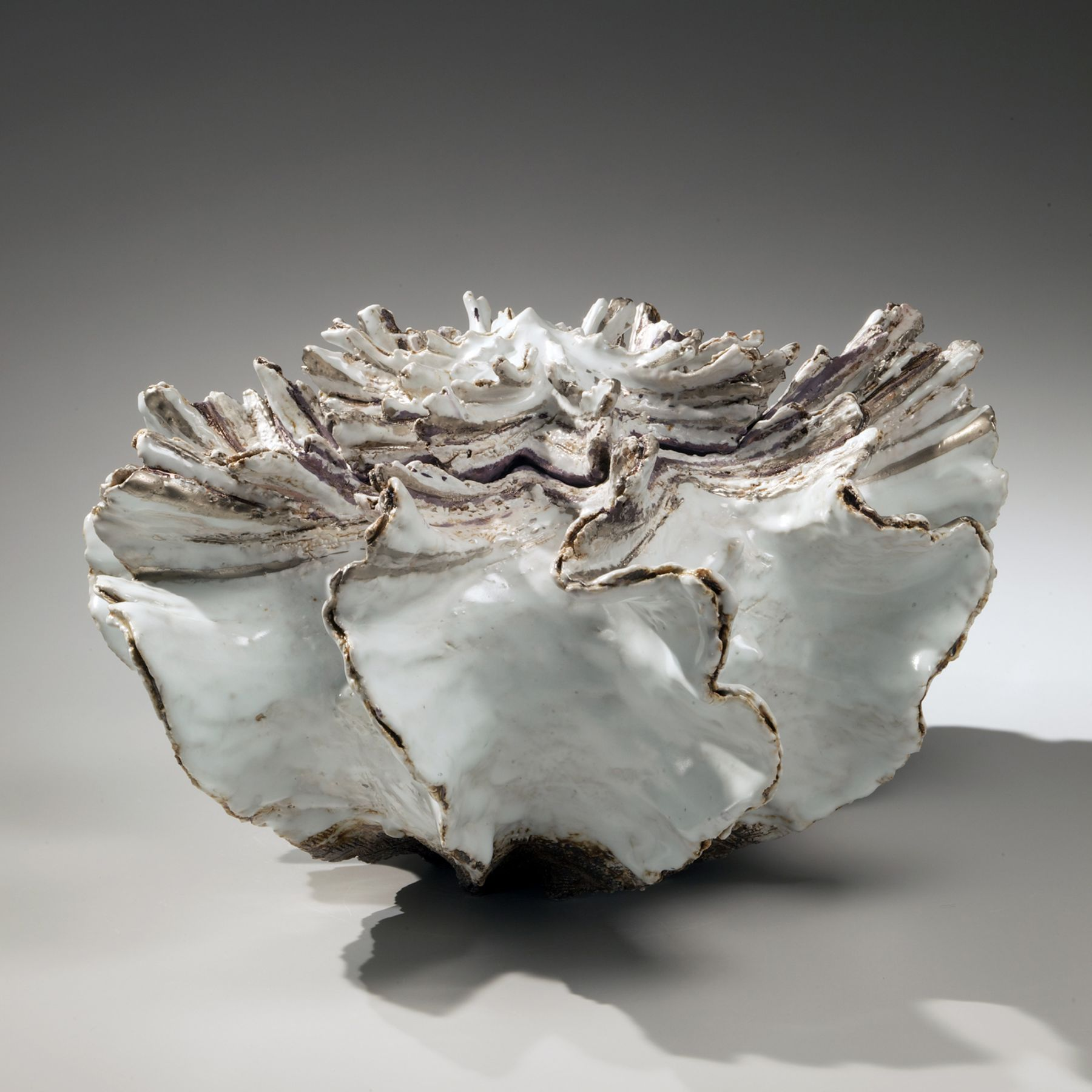 Low pleated shell-shaped covered vessel with streaked top, silver glaze along the flaring edges, white-glazed interior and purple-glazed interior rim, 2011