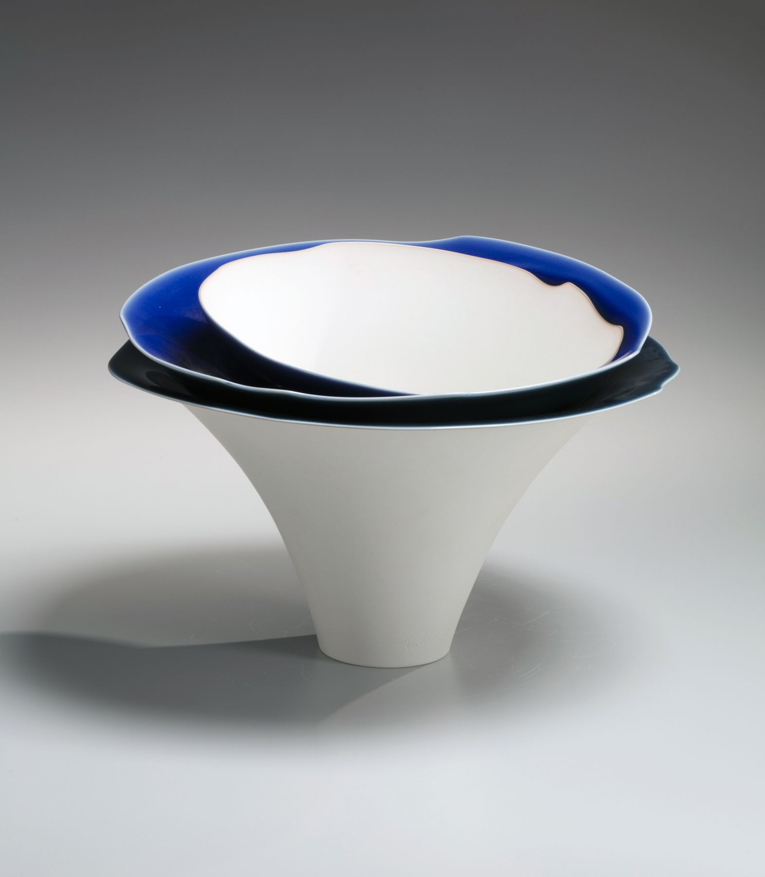 Fukumoto Fuku (b. 1973), Tiered sculpture of two shallow, and one large conical stacked bowls and decorated with blue glazes