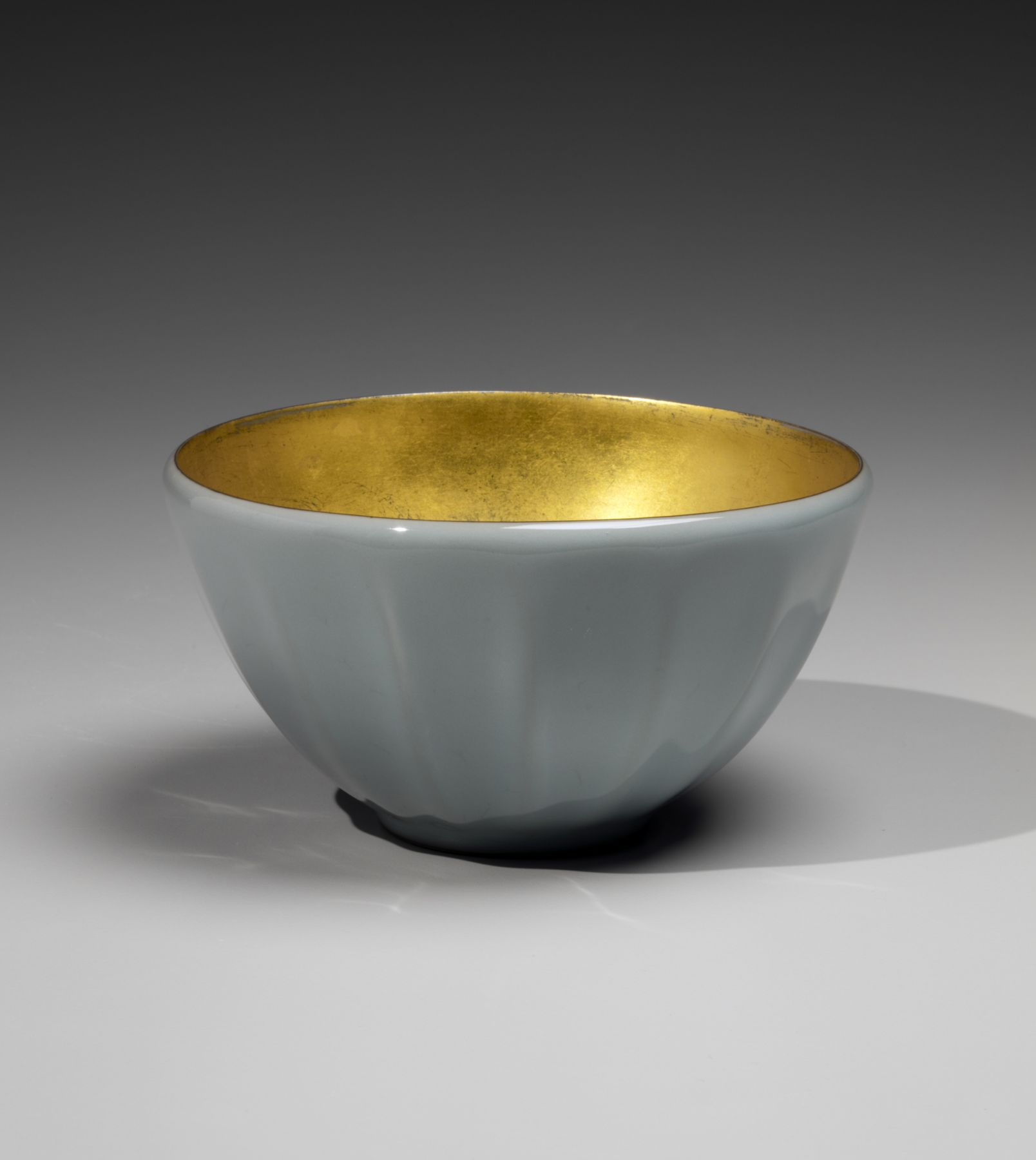 Kawase Shinobu (b. 1950), Fluted celadon teabowl with gold-leaf interior