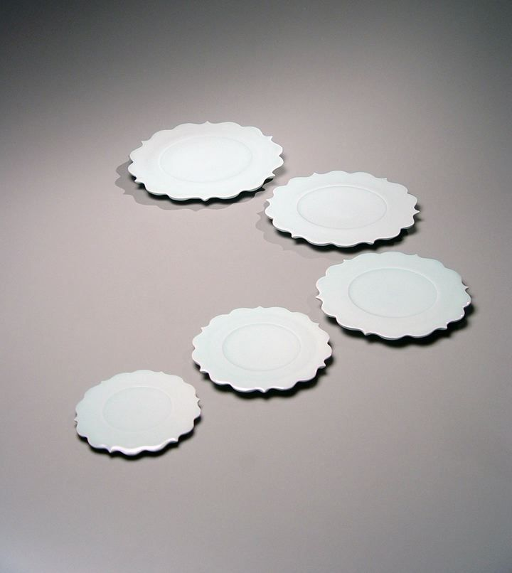 Set of five graduated bluish-white porcelain scalloped-edge plates, 2005